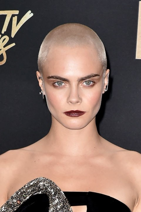 CARA DELEVINGNE WITH A SHAVED HEAD