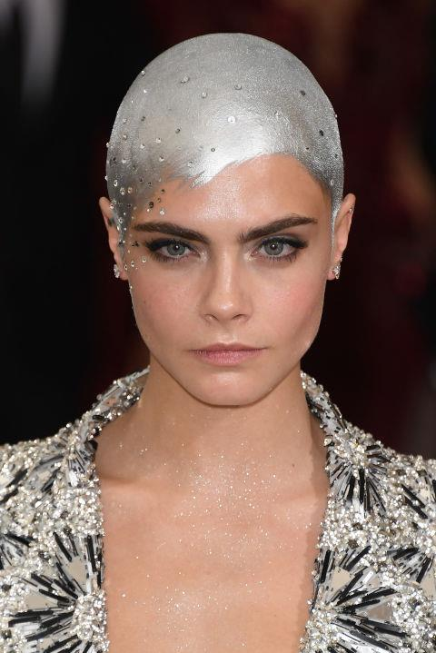 CARA DELEVINGNE PAINTS HER BALD HEAD SILVER FOR THE 2017 MET GALA