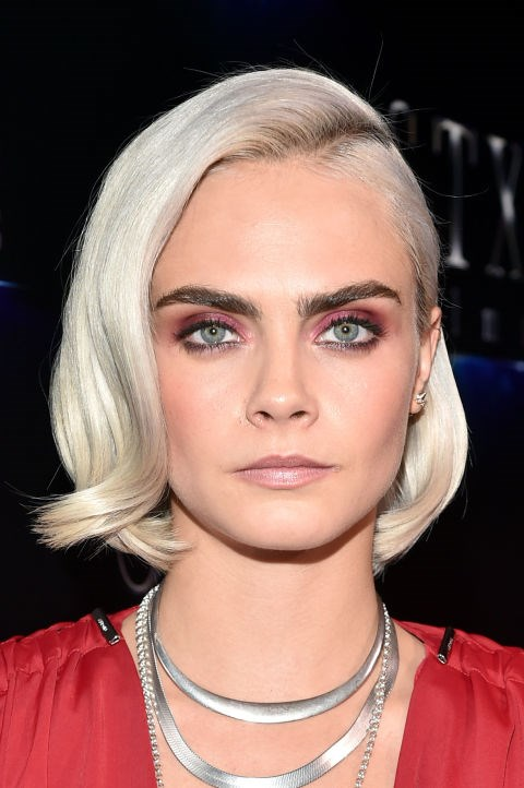 CARA DELEVINGNE WITH A WAVY WHITE BLONDE BOB
