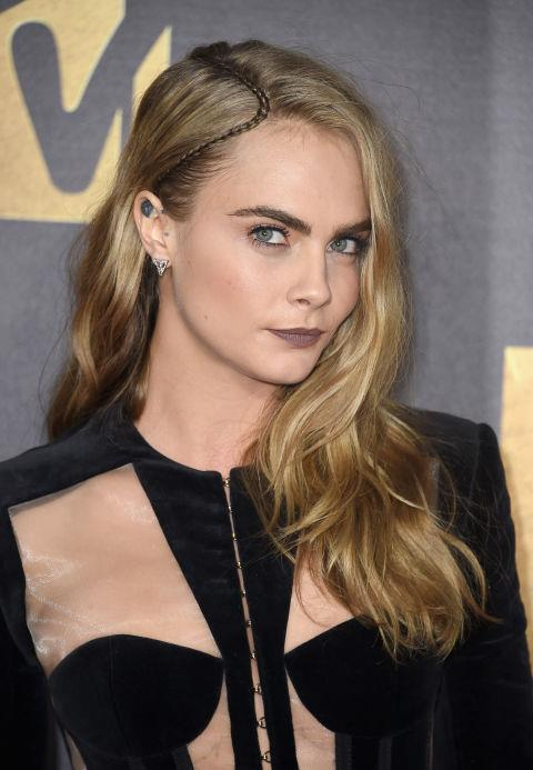 CARA DELEVINGNE WITH A TINY PARTING BRAID