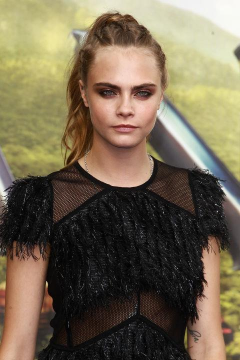 CARA DELEVINGNE WITH A BRAIDED PONYTAIL
