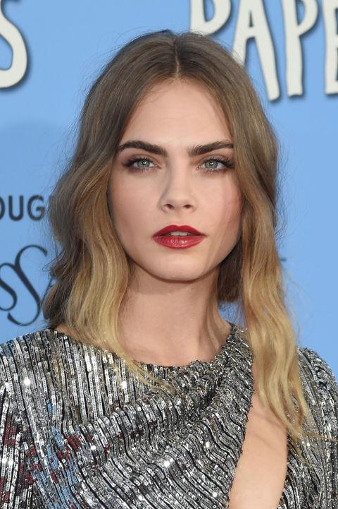 CARA DELEVINGNE WITH A TOUSLED UPDO