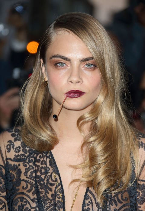 CARA DELEVINGNE WITH RED CARPET READY WAVES
