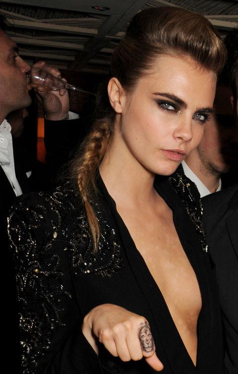 CARA DELEVINGNE WITH A QUIFF AND PLAIT