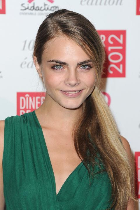 CARA DELEVINGNE WITH A SIDE PONYTAIL