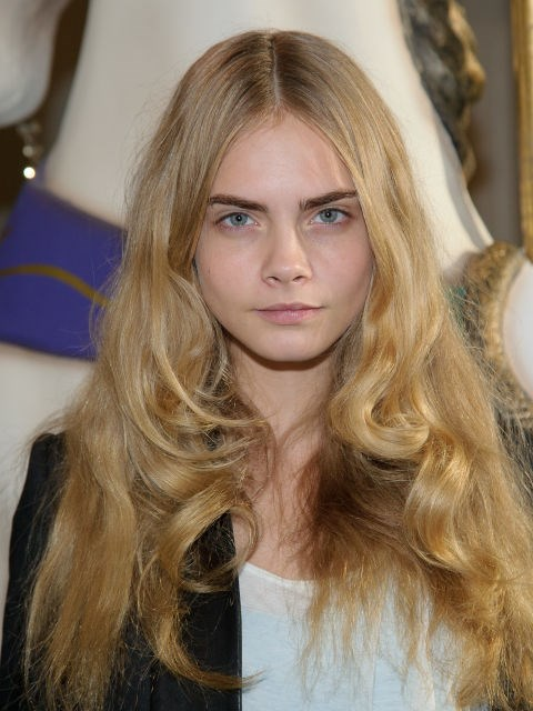 CARA DELEVINGNE WITH BIG, BOUNCY HAIR
