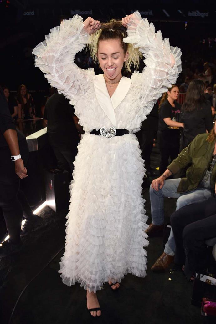 Wearing a white ruffled dress at the Billboard Music Awards in May.