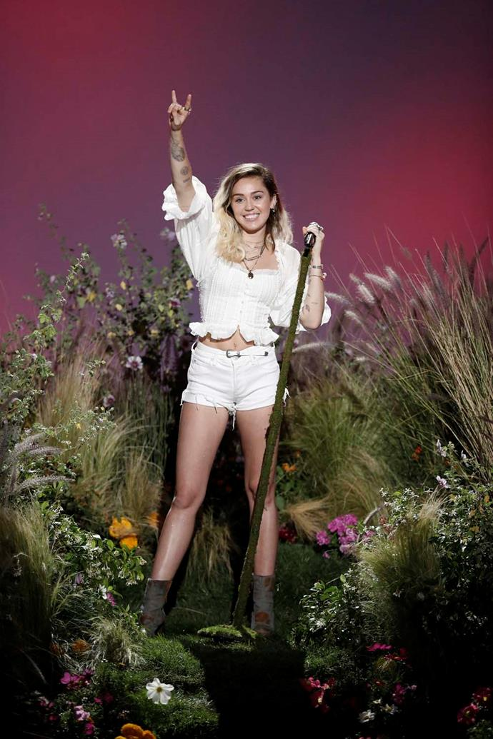 Miley performing on *The Voice* U.S.