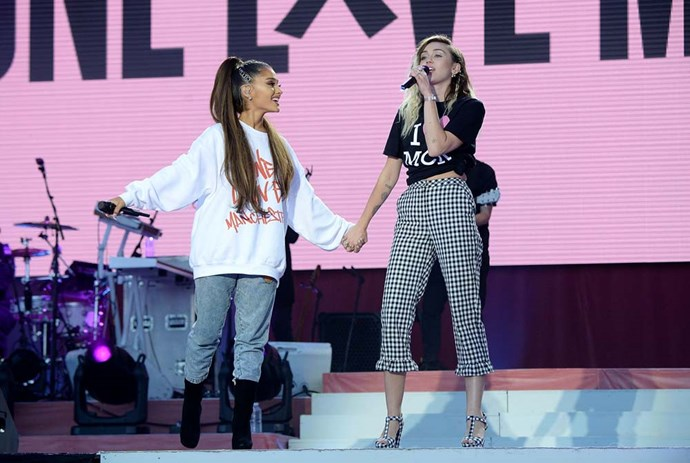 Wearing check cropped pants while performing with Ariana Grande at the One Love Manchester Benefit Concert.