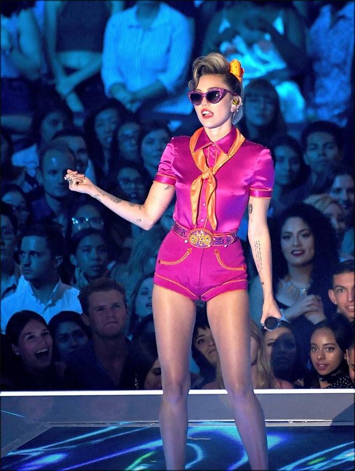 Wearing a hot pink satin ensemble at the 2017 MTV VMAs.