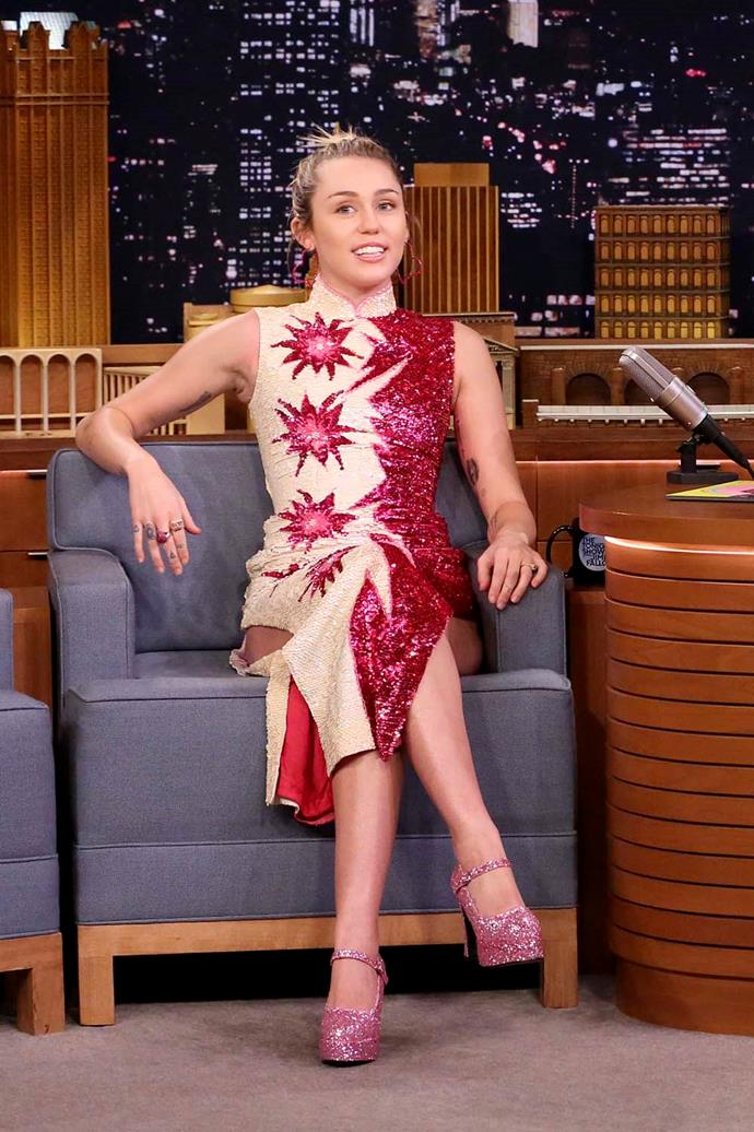 Being interviewed on *The Tonight Show Starring Jimmy Fallon*.