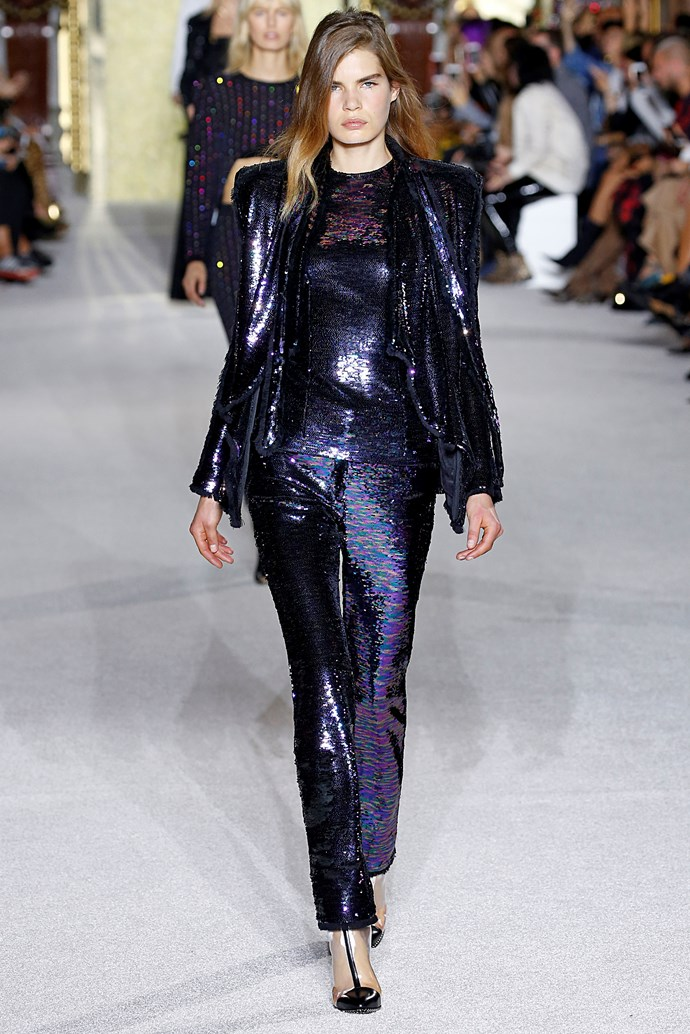 **Glitterati** Good ol' fashioned glamour is back in a *big* way—and we are very much into it. If the spring summer '18 runways taught us anything, it's that sequins and glitter are not limited to *RuPaul's Drag Race* and Britney Spears' Las Vegas residency. Our advice? Play it cool by pairing an OTT glitter dress with Vans or Converse.    Pictured: Balmain spring summer '18