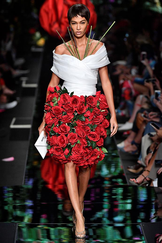 **It's all rosey**  Florals? For spring/summer? Honestly, this season's florals *were* kind of groundbreaking. They made an appearance on almost every runway, but were fresh and modern when printed on slinky white two-pieces. Or, you could throw caution to the wind and turn yourself into an *actual* bouquet of roses, like the models at Moschino (PSA: We don't actually recommend this).    Pictured: Moschino spring summer '18