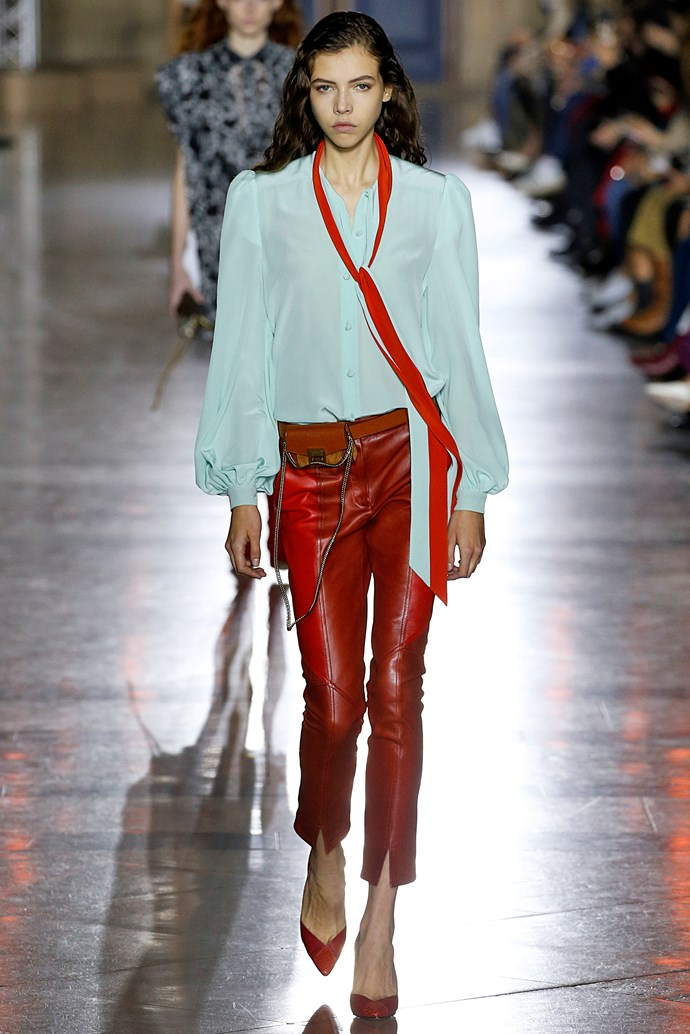 **Peasant blouses** Spring summer '18 not only reconfirmed our eternal love for peasant blouses, it also offered a handful of ingenius ways to style them. Our favourite? Louis Vuitton's pairing of a flowy, floral blouse worn under a grunge-y vintage-inspired tee.    Pictured: Givenchy spring summer '18