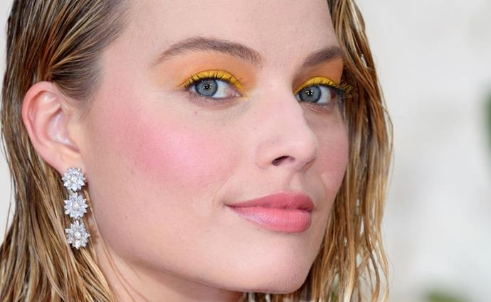 """**EGG YOLK YELLOW** <br><br> **Who's wearing it:** Standout acknowledgement goes to [Margot Robbie](https://www.elle.com.au/fashion/margot-robbie-beauty-routine-fragrance-calvin-klein-deep-euphoria-6902