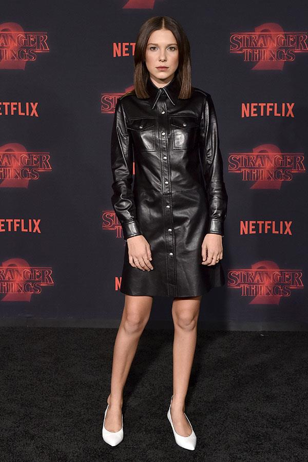 Wearing a sharp Calvin Klein leather shirt dress for the Stranger Things season 2 premiere in Los Angeles on 26 October 2017.