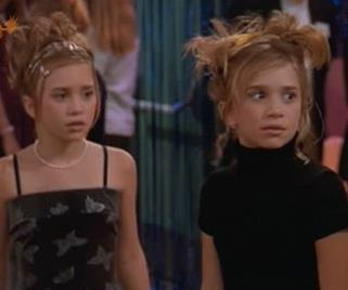 Twisted buns and butterfly clips. These hairstyles could not be more '90s if they tried.