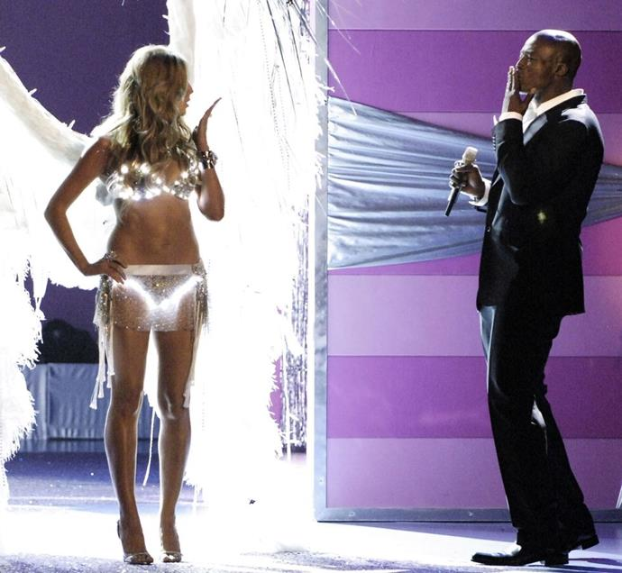 **Heidi Klum and Seal, 2005** <br><br> Sexy LED undies and kisses on the runway.