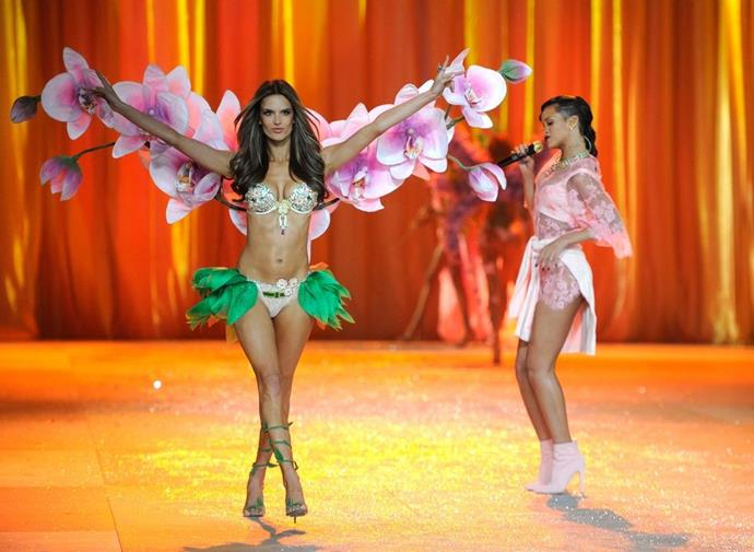 **Alessandra Ambrosio, 2012** <br><br> Alessandra, in the fantasy bra, blooming before our very eyes as Riri serenades her.
