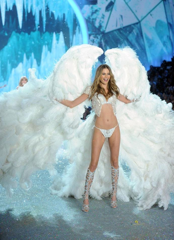 **Behati Prinsloo, 2013** <br><br> Behati's angel wings double as a fluffy cloud!
