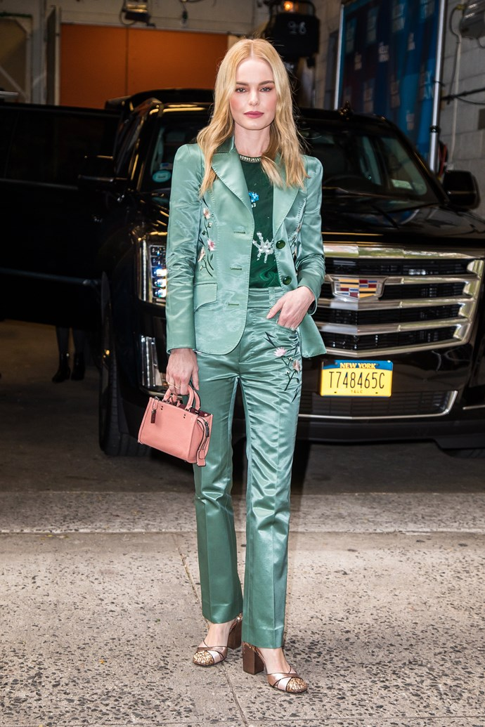 She then started her press tour on Live with Kelly and Ryan in a Coach 1941 jade-green silk suit. She paired it with a Coach bag and shoes.