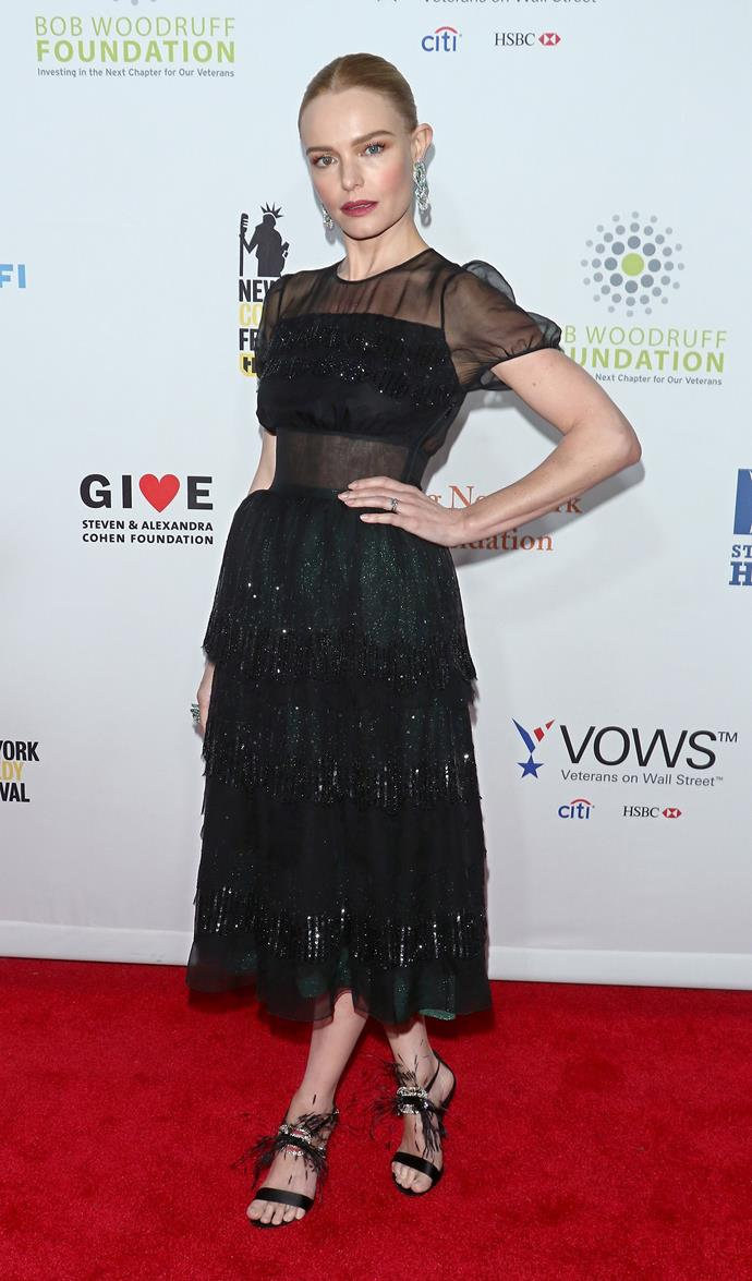 The actress started off at the 11th Annual Stand Up for Heroes, in a sheer black Rochas dress and Roger Vivier  sandals. The little puff sleeves and the full, ruffled skirt gave a sweet edge to negate the sexy feel.