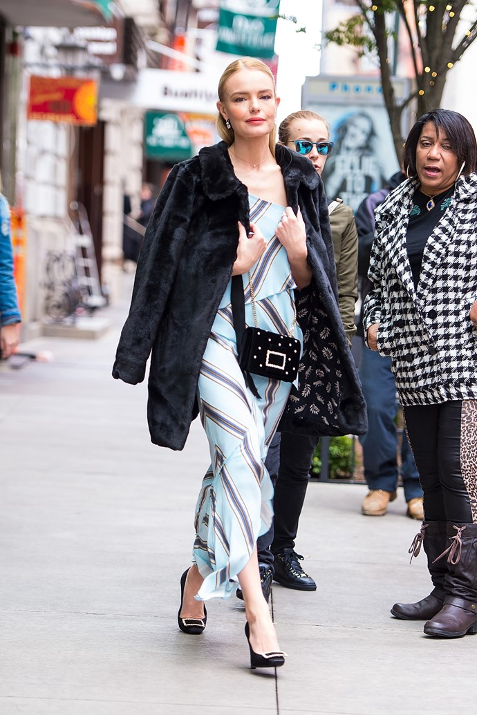 Swinging back to ladylike, the actress pulled on a striped midi dress with a faux fur jacket, and Roger Vivier shoes.