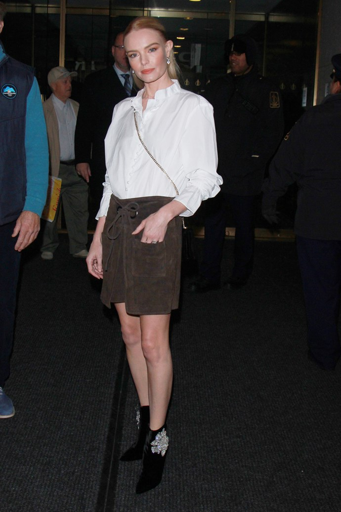 For her last appearance, Bosworth wore a suede khaki skirt and a white shirt.