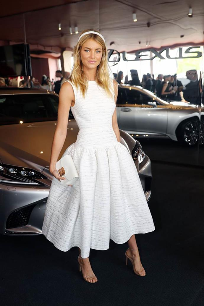 Elyse Taylor poses at the Lexus Marquee on AAMI Victoria Derby Day wearing Alex Perry.