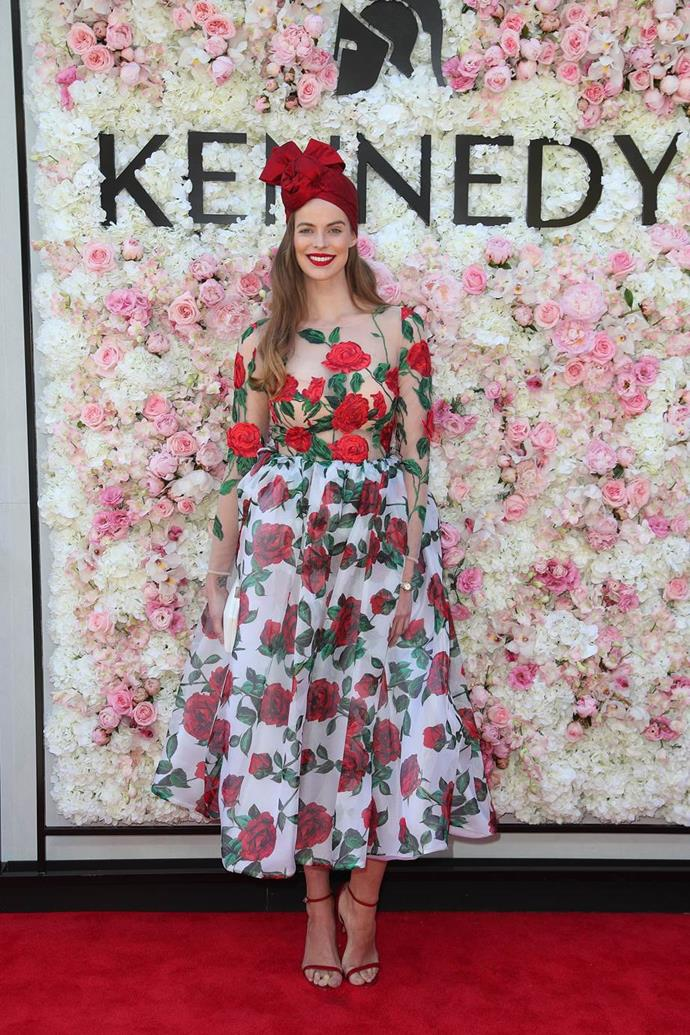 Robyn Lawley in a Con Ilio dress and Kerrie Stanley headpiece at Kennedy Oaks Day.