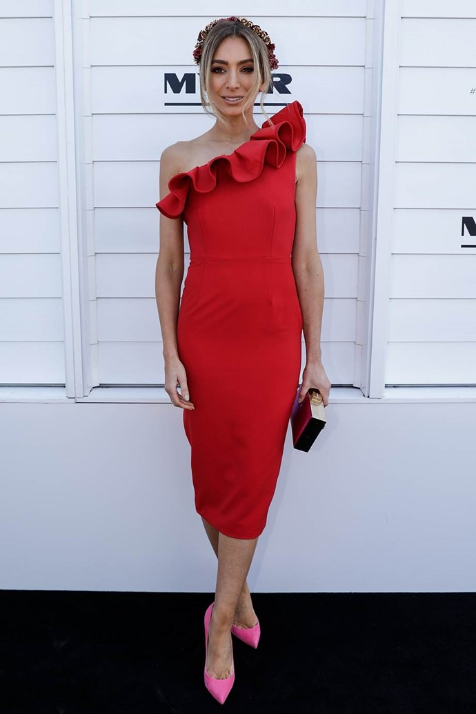 Nadia Bartel in a ATOÌR dress and EZARA/J headpiece at Kennedy Oaks Day.