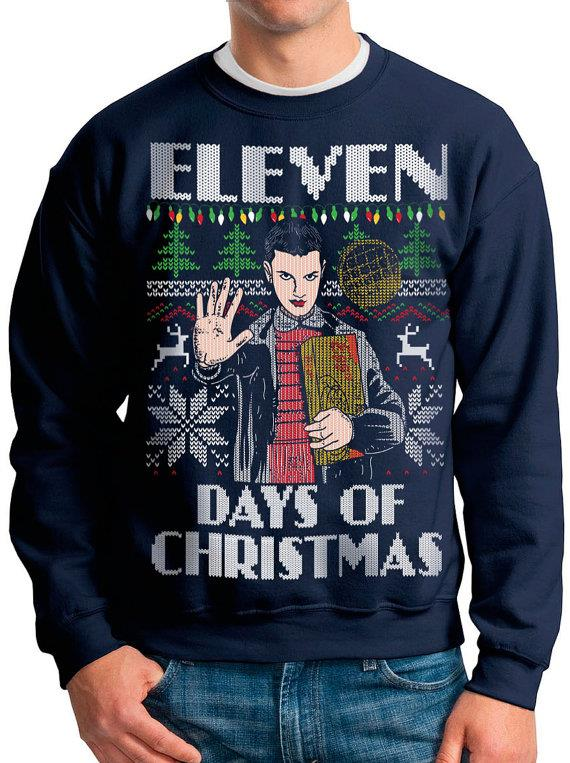 "Eleven Days Of Christmas Sweater, $34.23 from [Etsy](https://www.etsy.com/listing/473148500/stranger-things-ugly-christmas-sweater|target=""_blank"")."