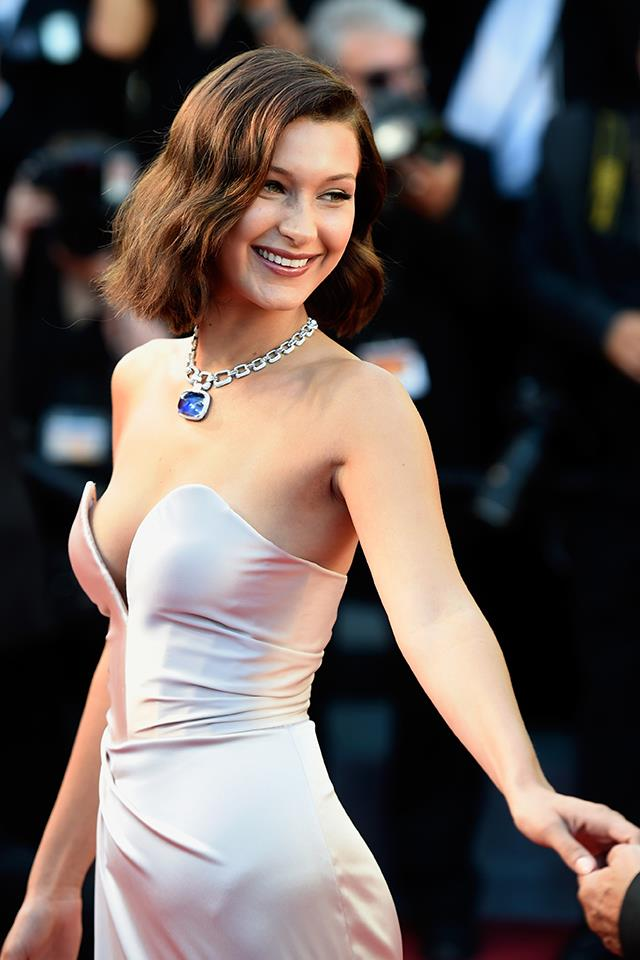 Bella smiling at the premiere of *Ismael's Ghosts* at the Cannes Film Festival in May 2017.