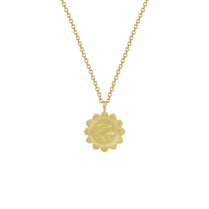 "*Capricorn* <br><br>Necklace, $1,708, [Me&Ro](https://www.meandrojewelry.com/collections/fine-jewelry-astrology/products/18k-gold-medium-lotus-capricorn-astrology-pendant|target=""_blank""
