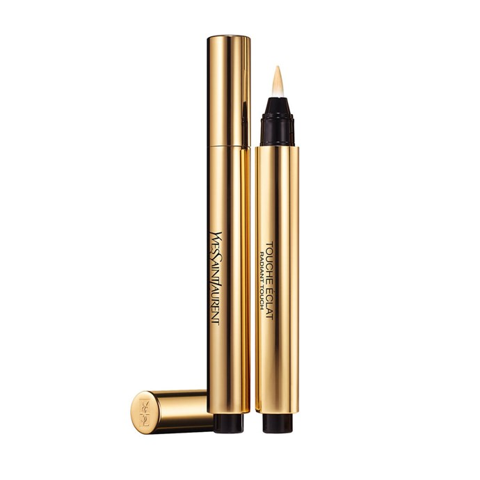 "**Yves Saint Laurent Touche Éclat, $68 at [Mecca](https://www.mecca.com.au/yves-saint-laurent/touche-eclat-radiant-touch/V-009111.html|target=""_blank"").**   When she's off-set, Markle says her ""routine is very simple—I call it the five-minute face."" She tells *Allure*, ""It's just Touche Éclat, curled lashes, mascara, Chap Stick, and a little bit of blush."""