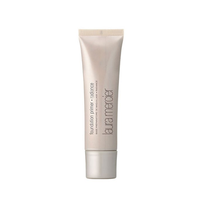 "**Laura Mercier Radiance Foundation Primer, $50 at [AdoreBeauty](https://www.adorebeauty.com.au/laura-mercier/laura-mercier-foundation-primer-radiance.html|target=""_blank"").**    Off-set, Markle applies Laura Mercier Radiance Foundation Primer before foundation. ""It's amazing because you can still see freckles but your skin has a glow."""