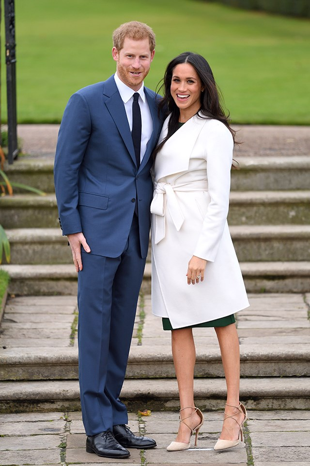 For their first photo call as an engaged couple, Meghan wore a white belted wrap coat by Canadian brand Line The Label over a green dress by P.A.R.O.S.H, and white Aquazzura shoes that wrapped around her ankles.