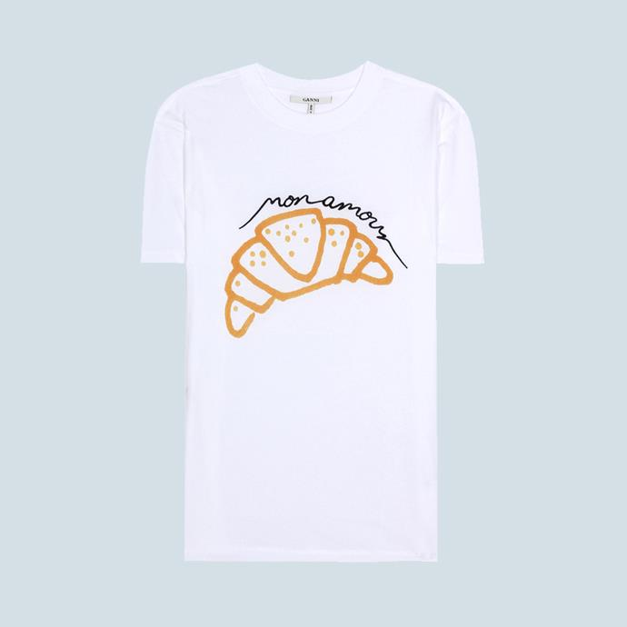 "T-Shirt, $91, [GANNI at mytheresa.com](https://www.mytheresa.com/en-de/001267-moulin-printed-cotton-t-shirt-820227.html?catref=category|target=""_blank""