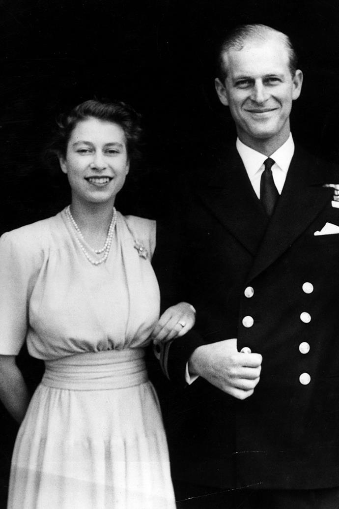 **Queen Elizabeth II and Prince Philip**  <br><br> Engaged: Announced July 10, 1947; Balmoral Castle, Scotland <br><br> The couple met when Elizabeth was only 13 years old, and Philip was 18 years old. After a month–long stay at Balmoral, Philip proposed to Elizabeth in 1946. The engagement ring, a three-carat round diamond ring set in platinum with several diamonds surrounding the main stone, was crafted using gems from a tiara that belonged to Prince Philip's mother. <br><br> Although Elizabeth's father approved of Philip, he asked that the couple keep their engagement a secret until the princess turned 21 the following year.