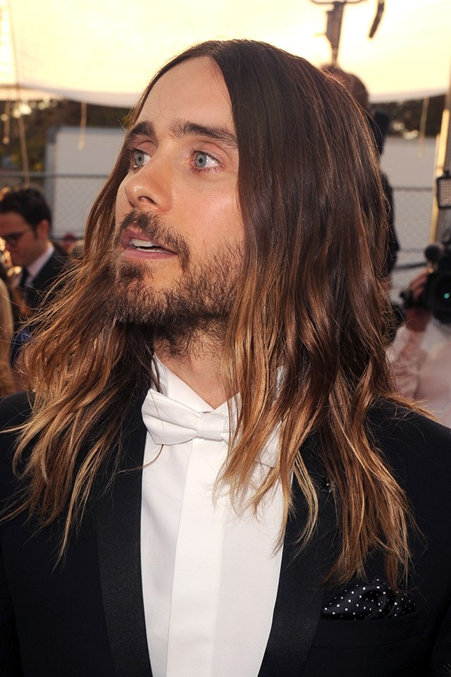 **Jared Leto** <br><br> Ditto Jared Leto circa 2014, when he was getting accolades during awards season for his work as *Dallas Buyers Club*. His hair was long, it always had the perfect wavy kink, and yes, the balayage situation was extremely good.