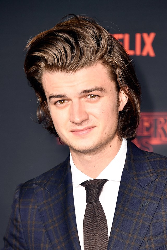 """**Joe Keery** <br><br> Best known and loved for his role as Steve on *Stranger Things*, Joe's hair got its own shout-out on the Netflix show, when Dustin (Gaten Matarazzo) asked Steve about the secret to his perfect hair. On the show, it was products by Fabergé Organics, including four puffs of the Farrah Fawcett spray. In real life, [Joe has said]( http://www.vulture.com/2017/10/joe-keery-steve-stranger-things-2.html