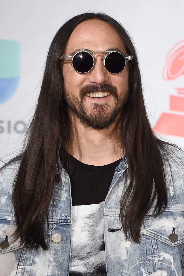 **Steve Aoki** <br><br> This is how some of us with naturally dark hair imagine our hair would be if we had just let it grow out naturally, with the occasional trim to maintain hair health. It's proof that one all-over shade is not boring.