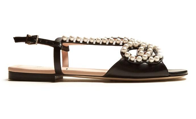 "Flats, $1,300, Fendi at [Matches Fashion](https://www.matchesfashion.com/au/products/Fendi-Pearl-Land-embellished-leather-sandals-1178503|target=""_blank"")"