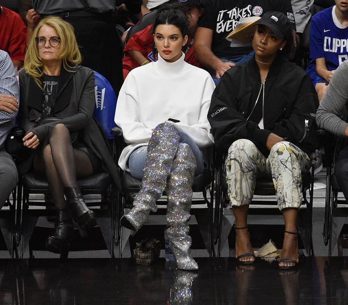 That time Kendall Jenner wore $10,000 sparkly Saint Laurent boots to watch a basketball game.