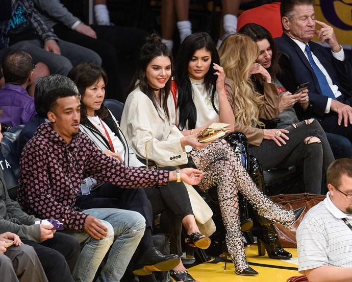 That time Kendall Jenner wore Sophia Webster's lace-up Delphine boots and Kylie Jenner wore patent Kurt Geiger over-the-knee boots at an LA Lakers game.