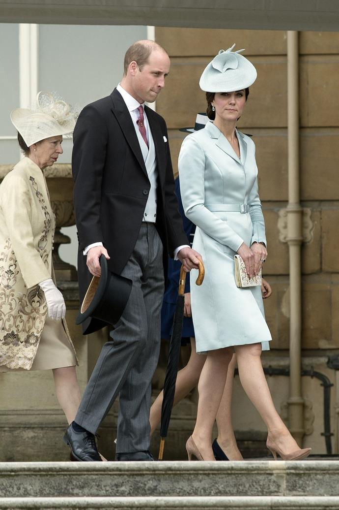 **$1037** On May 16, Kate attended the Buckingham Palace Garden Party in a blue Christopher Kane outfit she already owned and a new hat