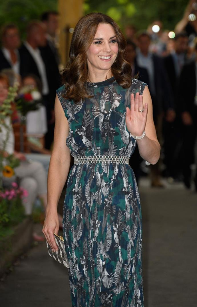 **$1,452** On July 20, Kate attended a reception at Berlin's Clärchens Ballhaus Kate dazzled in a three-strand pearl bracelet once worn by Diana. She also wore a Markus Lupfer chiffon-silk maxi, Soru earrings and carried a new clutch.