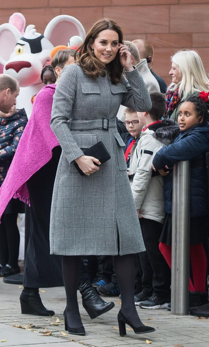 **$1,656** On December 6, Kate arrived at the Manchester Central Convention Centre in a Goat dress and L.K.Bennett coat.