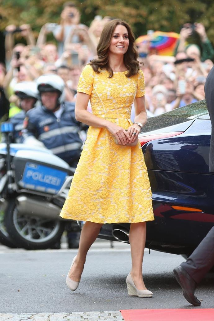**$1,841** On July 20, Kate visited the German Cancer Research Institute and Heidelberg market in a custom Jenny Packham dress with a Russell & Bromley Curvy clutch.