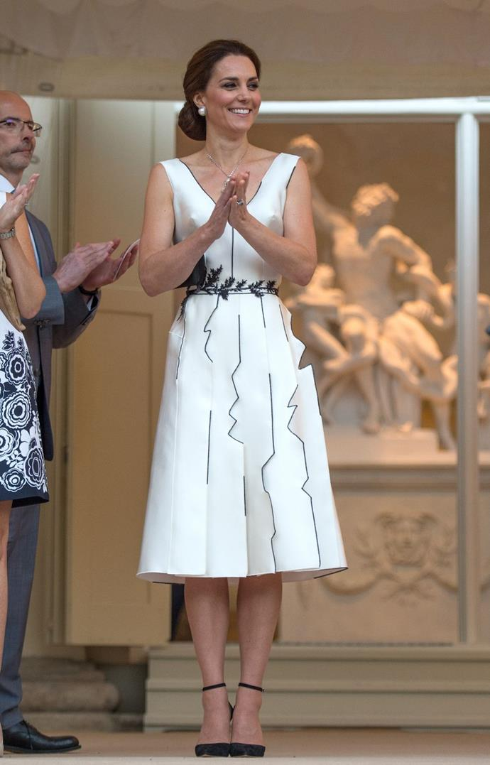 **$2,521** On July 17, Kate attended a birthday party in honor of the Queen at Warsaw's Lazienki Park. She wore a dress by Polish designer Gosia Baczynska.